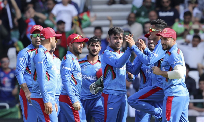 In this 2019 file photo, Afghanistan's Rashid Khan, centre right, celebrates with teammates after the dismissal of Pakistan's Haris Sohail during the Cricket World Cup match between Pakistan and Afghanistan at Headingley in Leeds, England. — AP