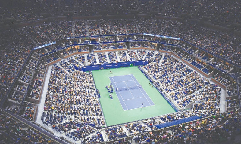 AN OVERVIEW shows the Arthur Ashe Stadium during the US Open men's singles first-round match between Serbia's Novak Djokovic (bottom) and Holger Rune of Denmark at the USTA Billie Jean King National Tennis Center.—AFP