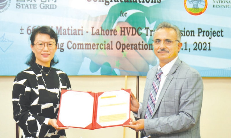 PAK Matiari-Lahore Transmission Line Company CEO Zhang Lei (left) and National Transmission and Despatch Company Managing Director Azaz Ahmad attend a ceremony at Wapda House in Lahore to mark the launch of commercial operations of the 660kV High-Voltage Direct Current transmission line on Wednesday.—Dawn