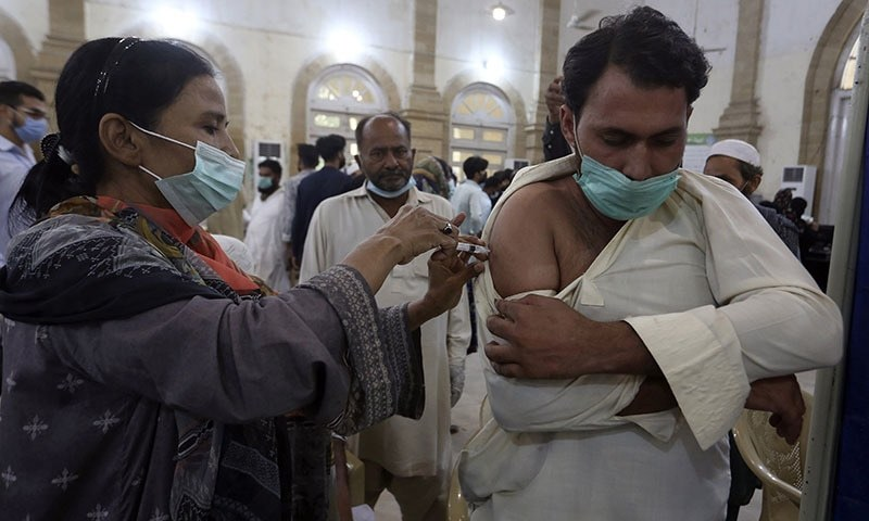 A man receives a shot of the Sinovac Covid-19 vaccine from a healthcare worker at a vaccination center in Karachi. — AP/File