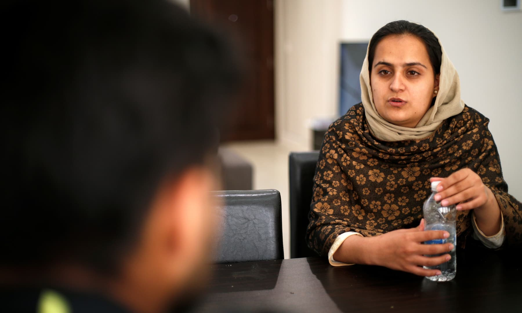 Afghan news anchor Beheshta Arghand speaks to her brother at a temporary residence compound in Doha, Qatar on September 1, 2021. — Reuters