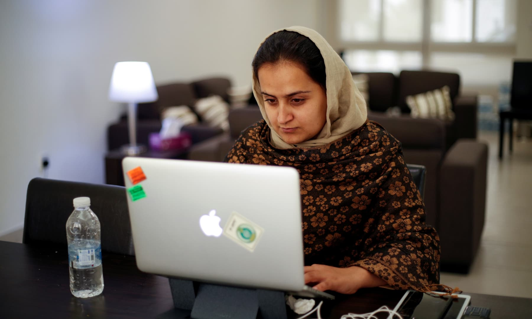 Afghan news anchor Beheshta Arghand works on a laptop at a temporary residence compound in Doha, Qatar on September 1, 2021. — Reuters