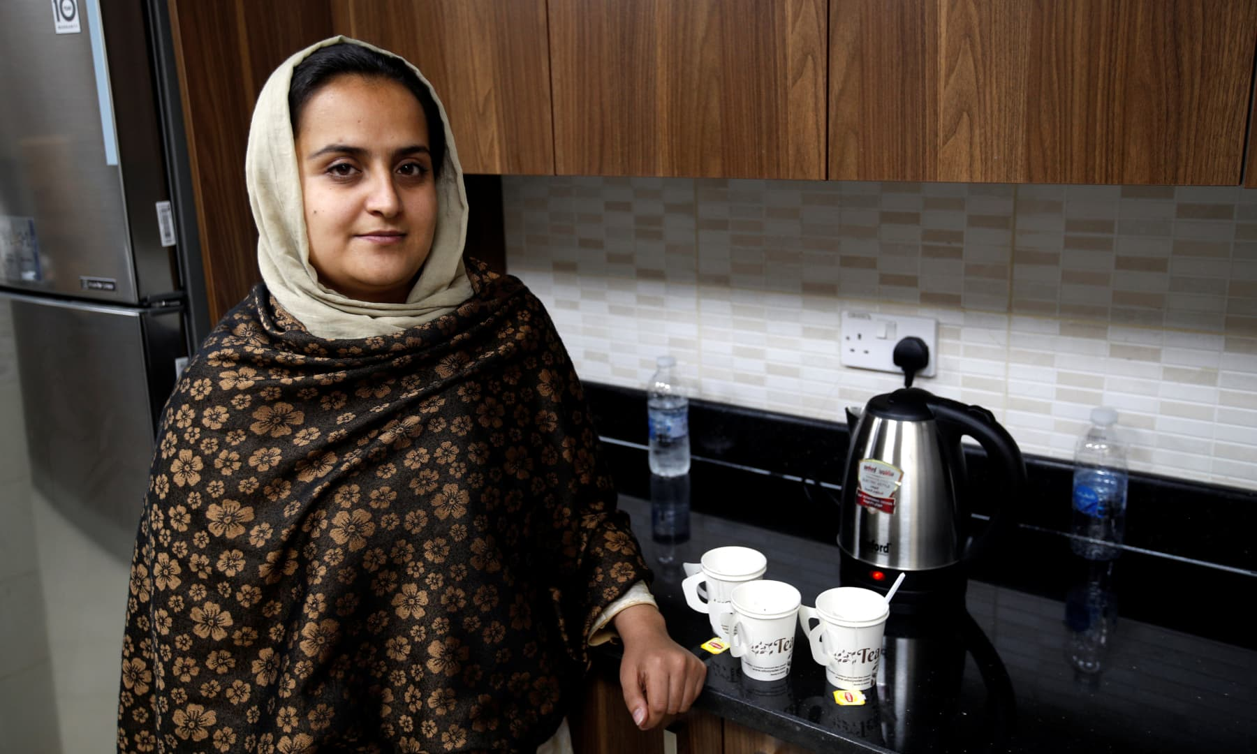 Afghan news anchor Beheshta Arghand poses for a photo as she makes her afternoon tea at a temporary residence compound in Doha, Qatar on September 1, 2021. — Reuters