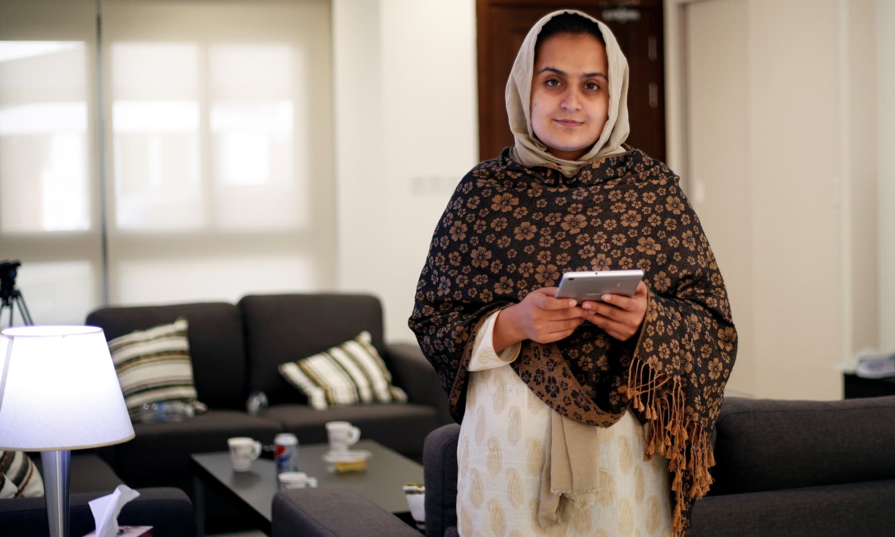Afghan news anchor Beheshta Arghand poses for a photo at a temporary residence compound in Doha, Qatar on September 1, 2021. — Reuters