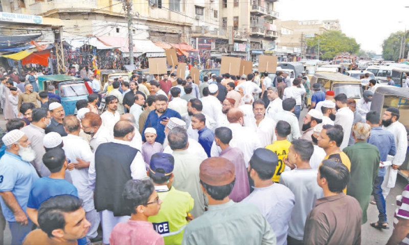 TRADERS block M.A. Jinnah Road near Lighthouse on Thursday in protest against 'discriminatory' lockdowns in Karachi and Hyderabad.—PPI
