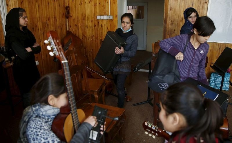 Members of the Zohra orchestra, an ensemble of 35 women, practises during a session, at Afghanistan's National Institute of Music, in Kabul, Afghanistan on April 4, 2016. — Reuters