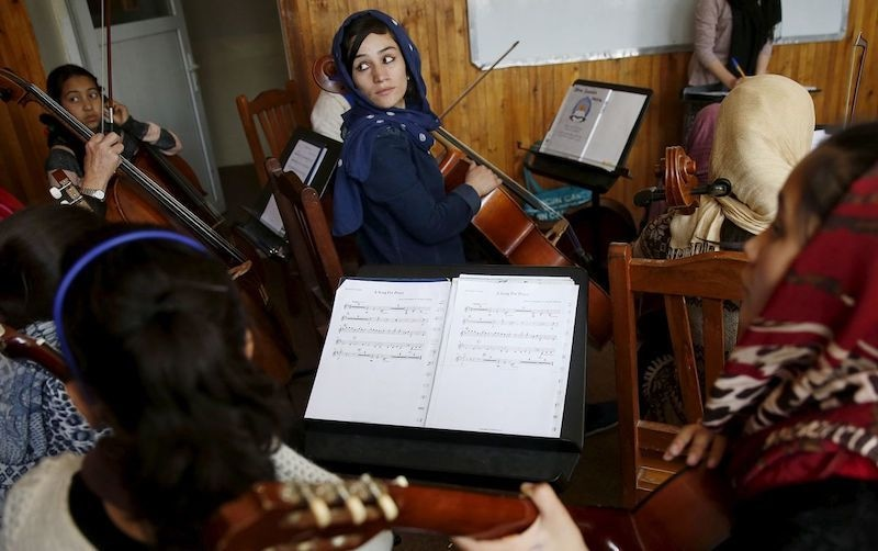 Members of the Zohra orchestra, an ensemble of 35 women, practise during a session, at the National Institute of Music in Kabul on April 4, 2016. — Reuters