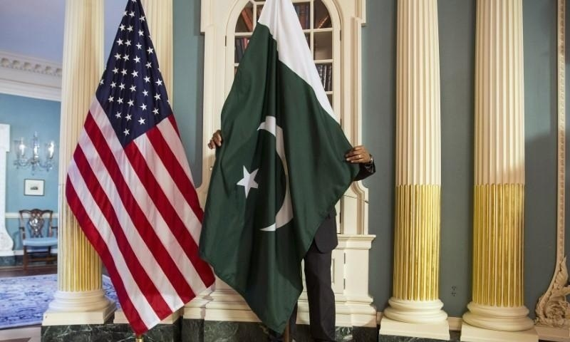 In this February 9, 2015 photo, a State Department contractor adjusts a Pakistan national flag before a meeting between then US secretary of state John Kerry and Pakistan's erstwhile interior minister Chaudhry Nisar Ali Khan on the sidelines of the White House Summit on Countering Violent Extremism at the State Department in Washington. — Reuters/File