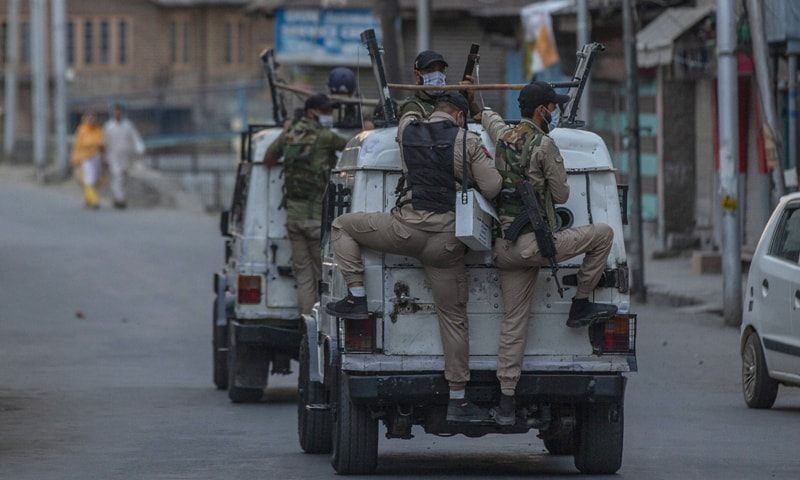 Indian policemen ride armoured vehicles after dispersing Kashmiri protesters during day-long security restrictions in Srinagar. — AP