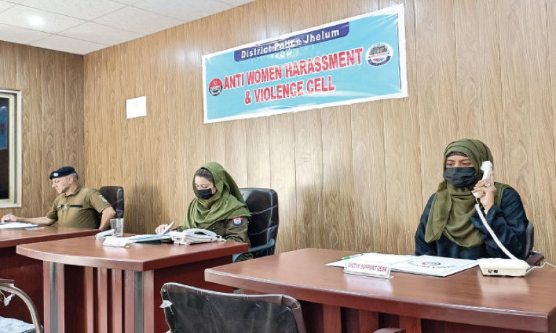 Lady police officers deputed at the Anti-Women Harassment and Violence Cell set up in Jhelum. — Dawn