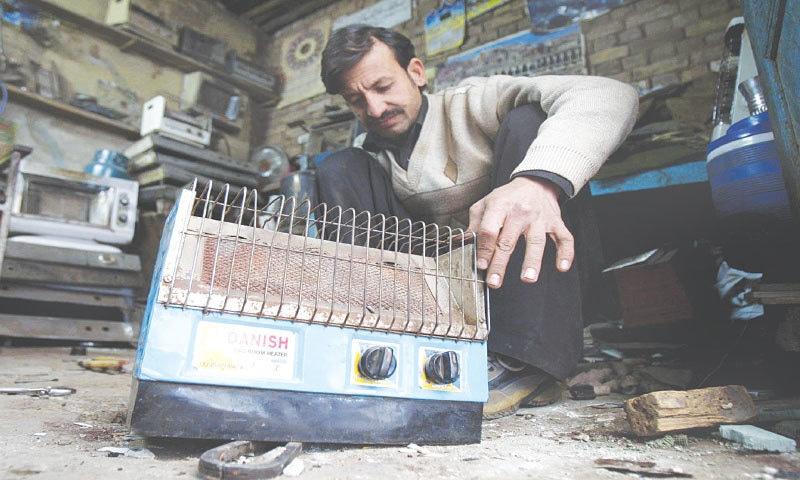 A worker in Peshawar repairs a gas heater | Shahbaz Butt/White Star