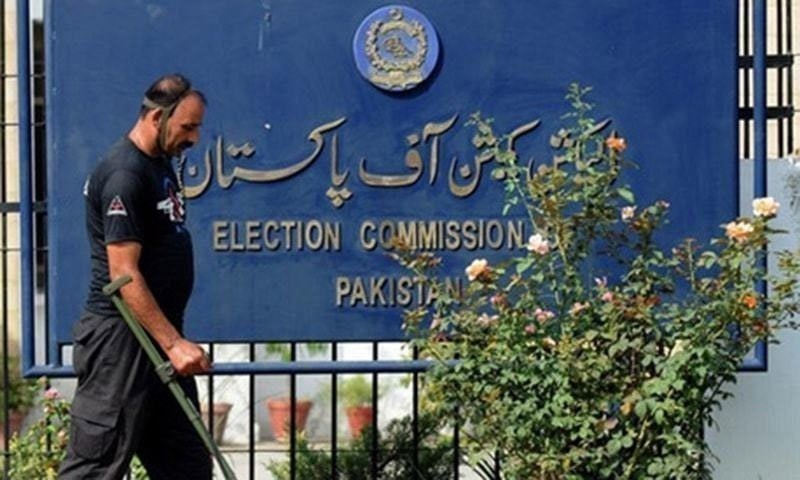 A security official uses a metal detector to check the area of the Election Commission of Pakistan (ECP) in Islamabad.  — AFP/File