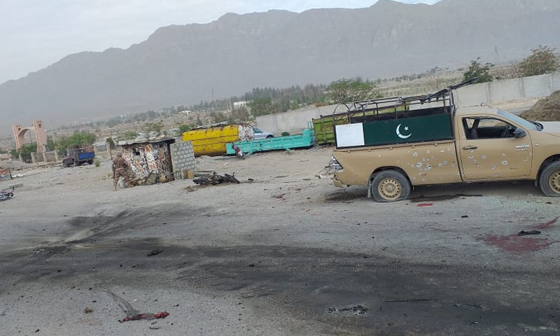 A damaged vehicle of security forces is seen at the site of the attack on the Frontier Corps (FC) checkpost on Quetta's Mastung Road on Sunday. — DawnNewsTV