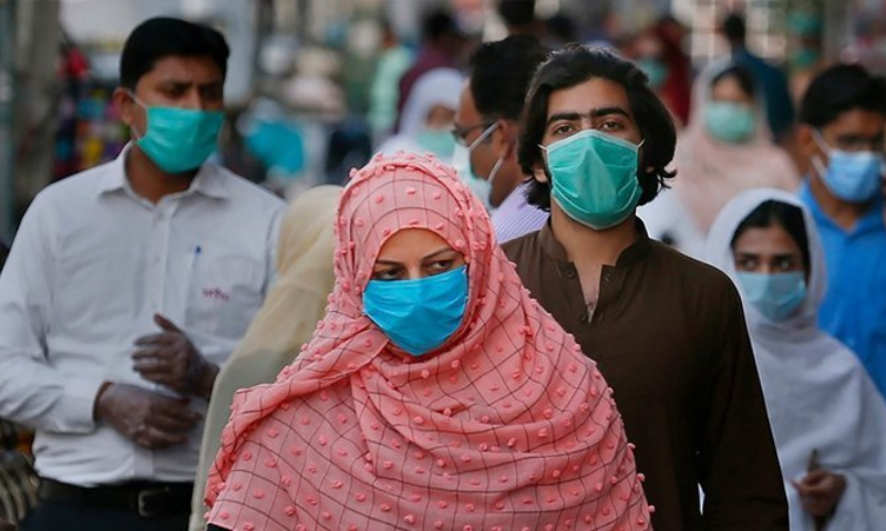 A woman walks in a market amid the spread of the coronavirus in Pakistan. — AFP/File
