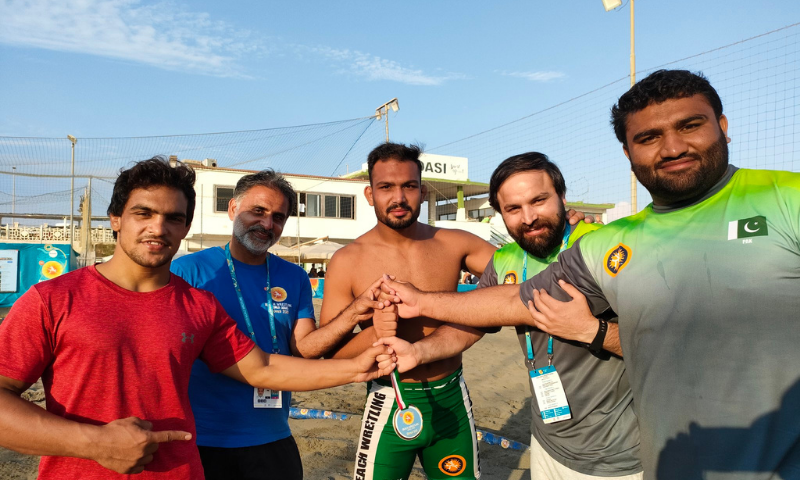 Inam Butt (centre) is pictured with his medal at the Beach Wrestling World Series on Saturday. — Photo courtesy Inam Butt Twitter