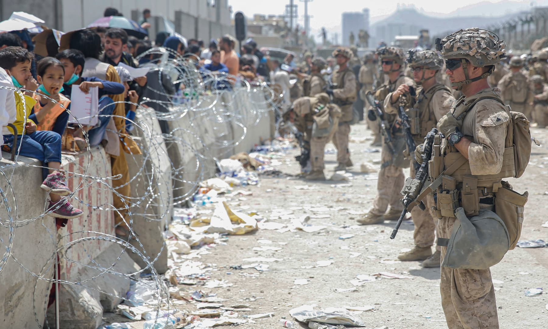 US Marines with Special Purpose Marine Air-Ground Task Force - Crisis Response - Central Command, provide assistance during an evacuation at Hamid Karzai International Airport in Kabul, Afghanistan on August 20, 2021. — AP
