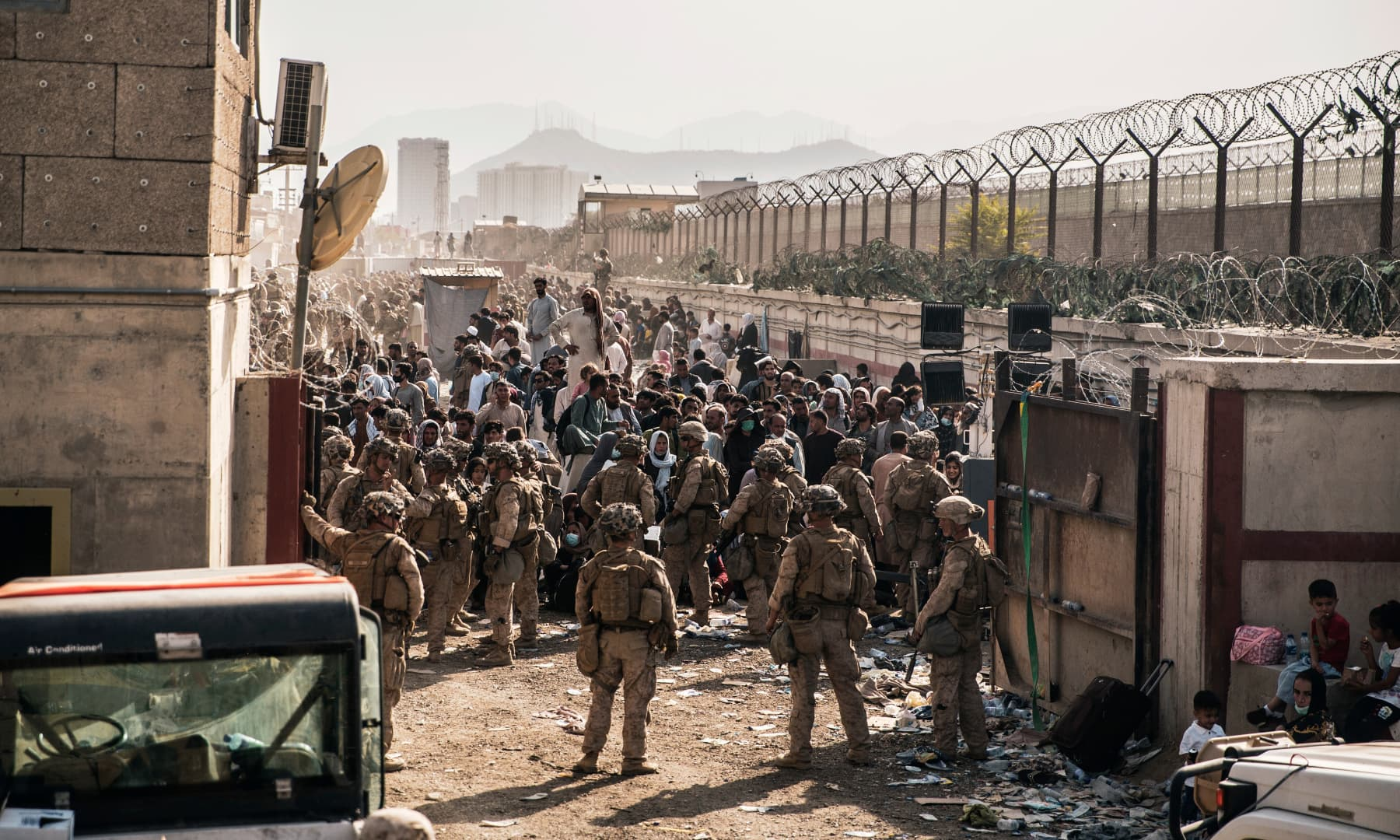 US Marines with Special Purpose Marine Air-Ground Task Force - Crisis Response - Central Command, provide assistance at an evacuation control checkpoint during an evacuation at Hamid Karzai International Airport in Kabul, Afghanistan on August 21, 2021. — AP