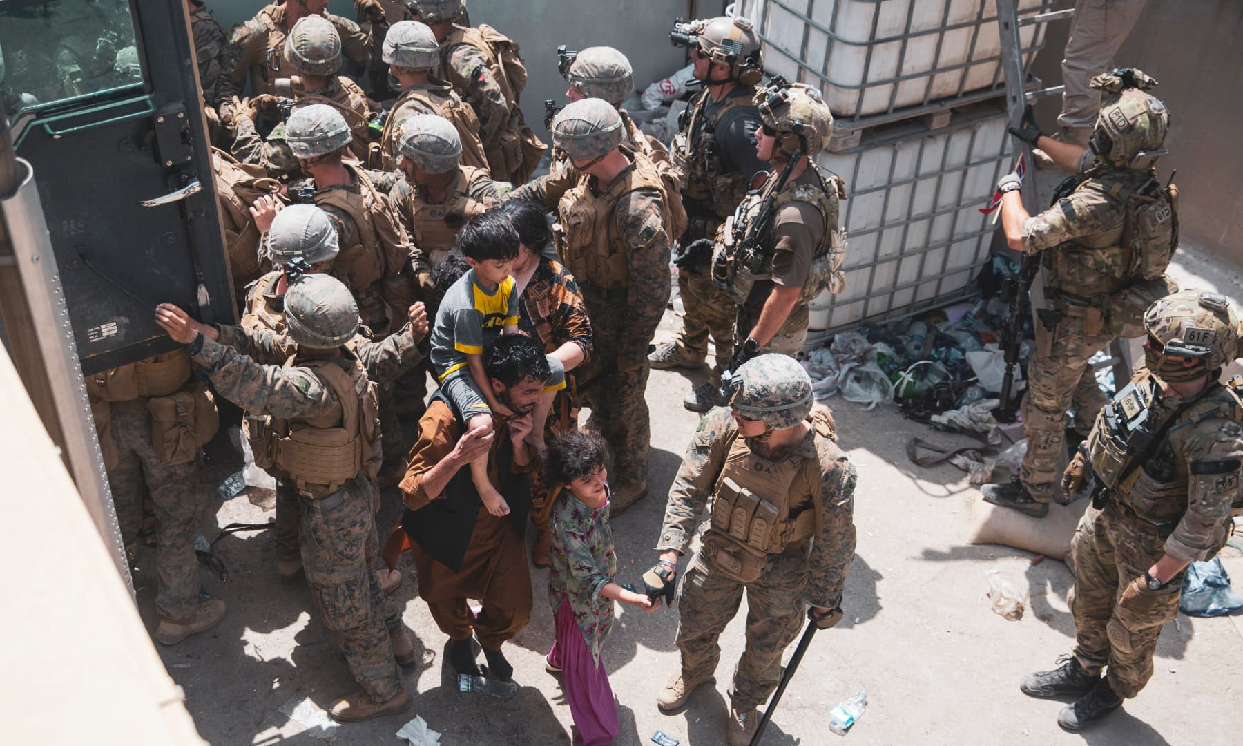 US Marines and Norweigian coalition forces assist with security at an Evacuation Control Checkpoint ensuring evacuees are processed safely during an evacuation at Hamid Karzai International Airport in Kabul, Afghanistan on August 20, 2021. — AP