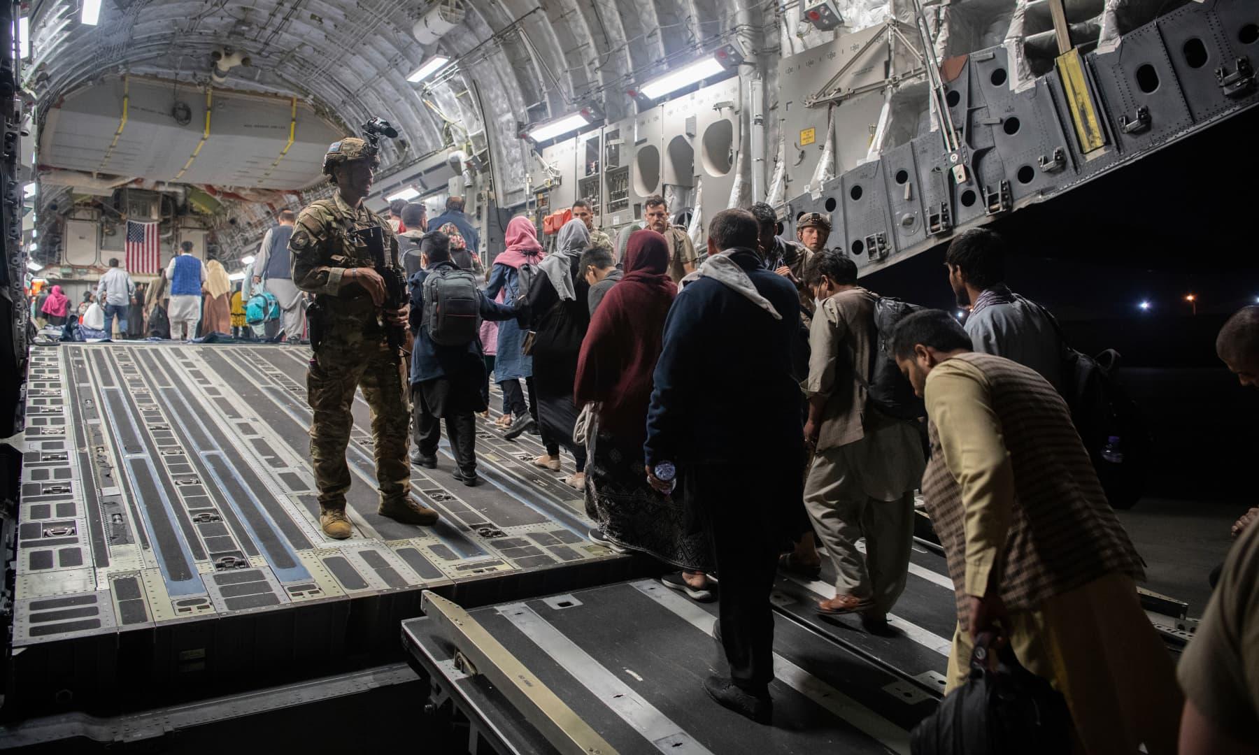 Afghan passengers board a US Air Force C-17 Globemaster III during the Afghanistan evacuation at Hamid Karzai International Airport in Kabul, Afghanistan on August 22, 2021. — AP