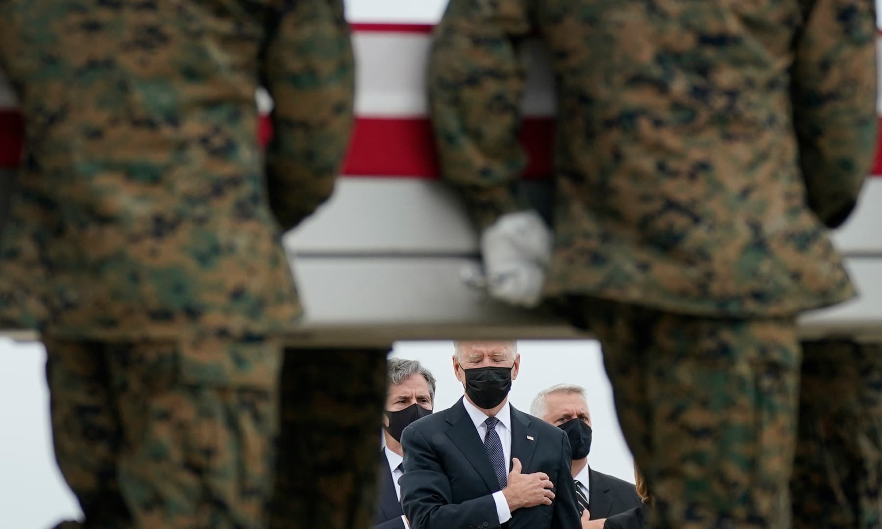 President Joe Biden watches as a carry team moves a transfer case containing the remains of Marine Corps Lance Cpl Kareem M Nikoui, 20, of Norco, California, during a casualty return at Dover Air Force Base, Delaware, US on August 29, 2021. — AP
