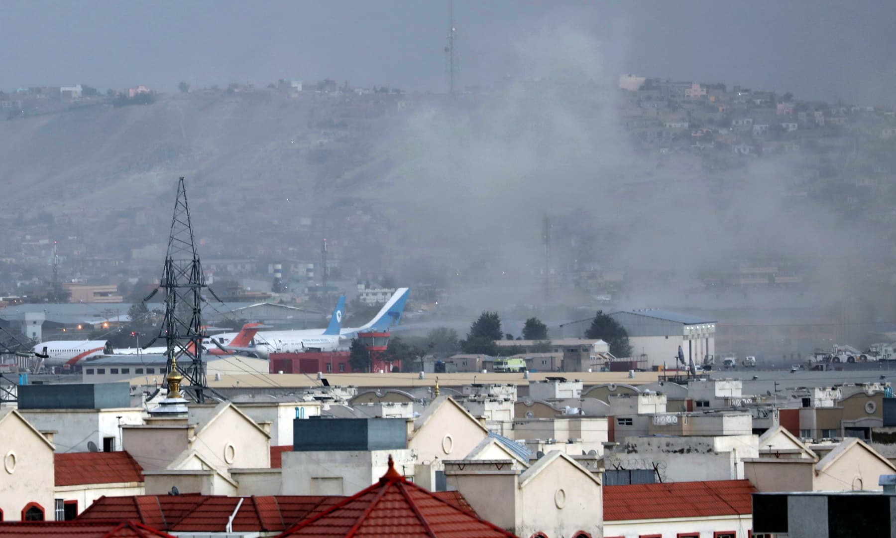 Smoke rises from a deadly explosion outside the airport in Kabul, Afghanistan on August 26, 2021. — AP