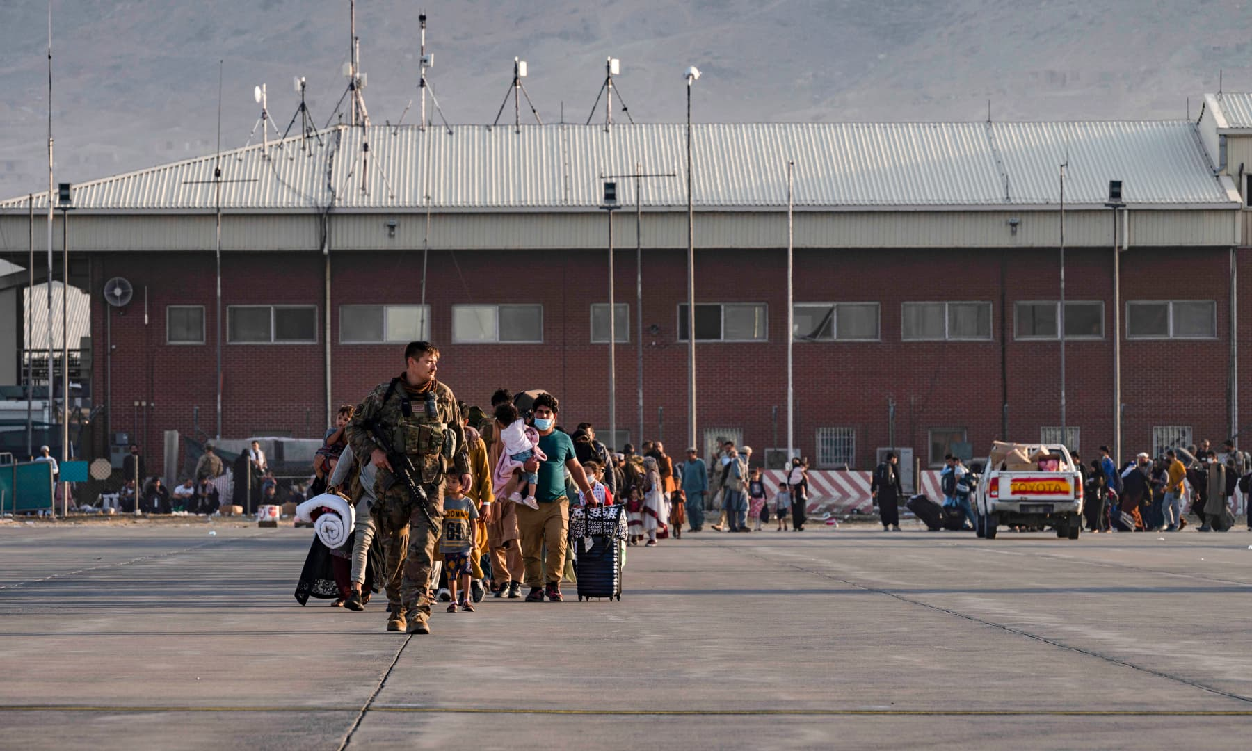 A US Air Force airman guides evacuees to board a US Air Force C-17 Globemaster III at Hamid Karzai International Airport in Kabul, Afghanistan on August 24, 2021. — AP
