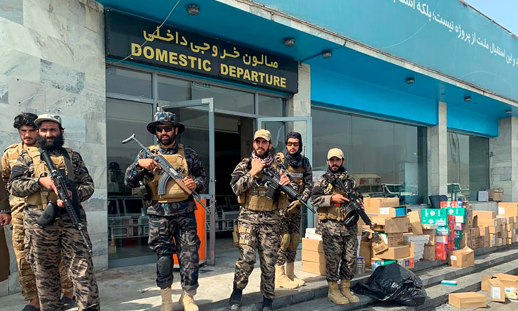 Taliban fighters stand guard inside the Hamid Karzai International Airport after the US withdrawal in Kabul, Afghanistan on August 31, 2021. — AP