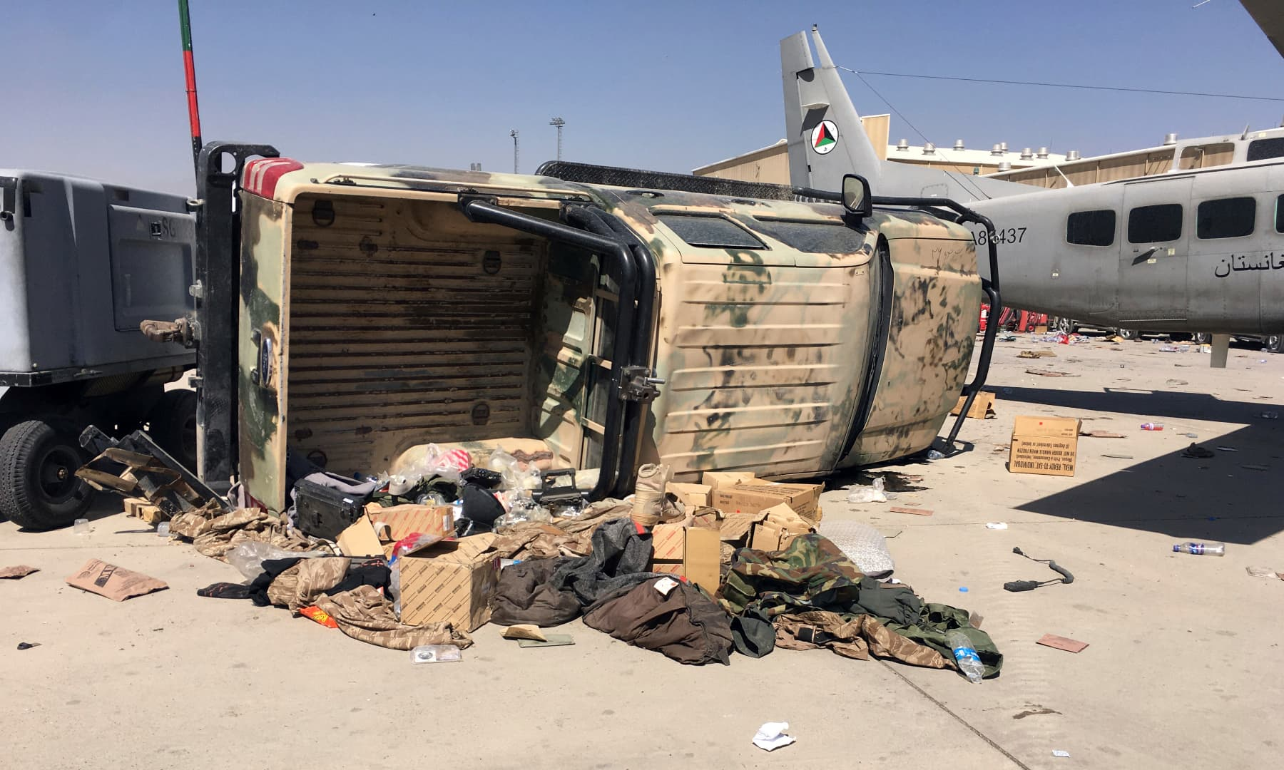 A damaged Afghan military airplane and vehicle are seen after the Taliban's takeover inside the Hamid Karzai International Airport in Kabul, Afghanistan on September 5, 2021. — AP