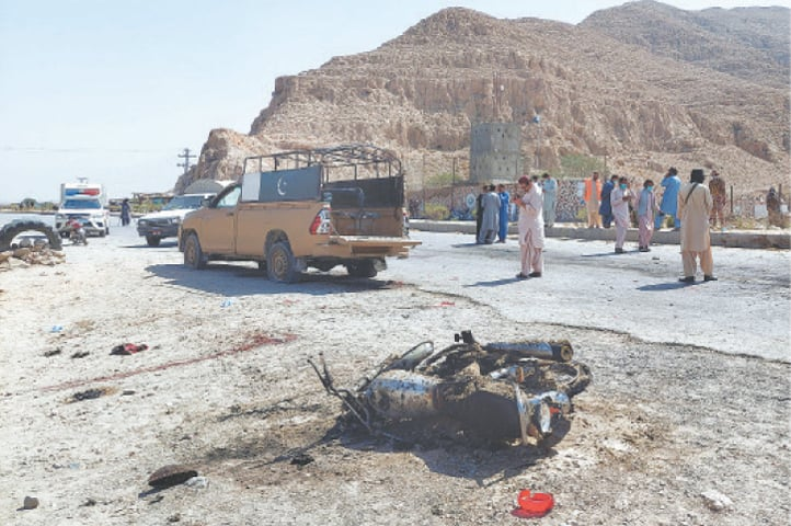 PEOPLE gather at the scene of the suicide attack near Quetta on Sunday.—Reuters