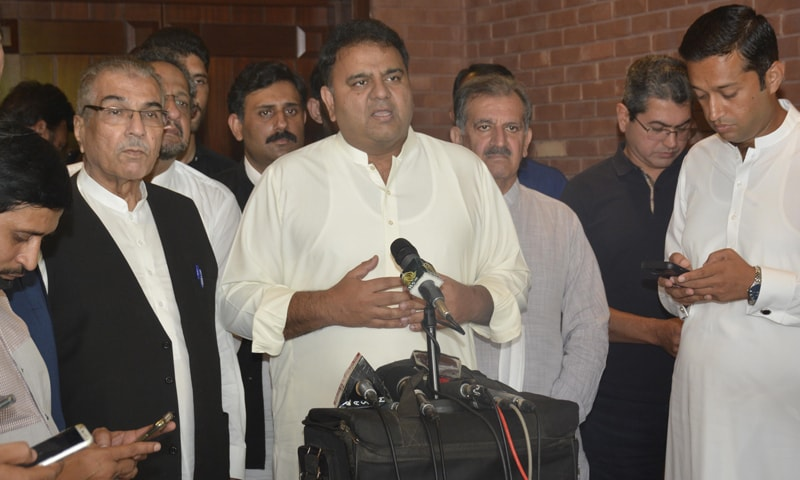 Information Minister Fawad Chaudhry speaks to the media in Lahore on Sunday. — Photo courtesy PID website