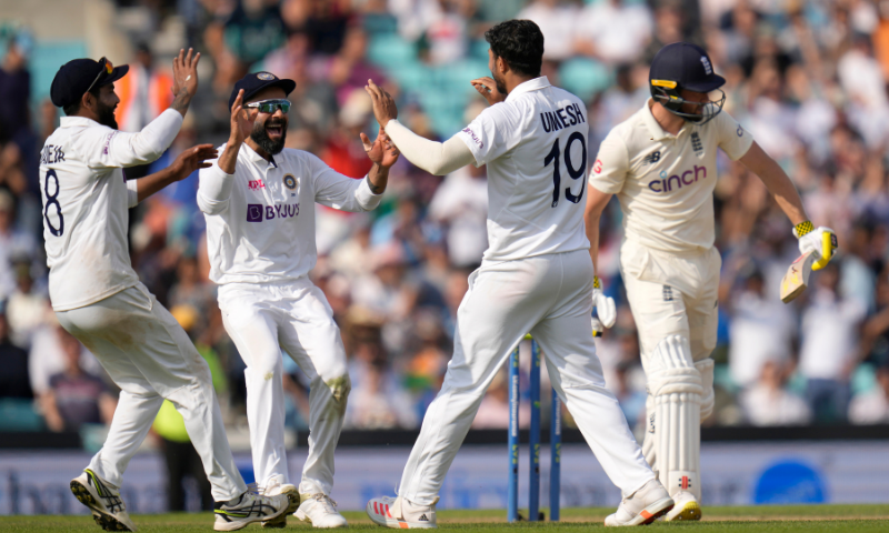 India's Umesh Yadav celebrates taking the wicket of England's Chris Woakes on day five of the fourth Test match at The Oval cricket ground in London, on Monday. — AP