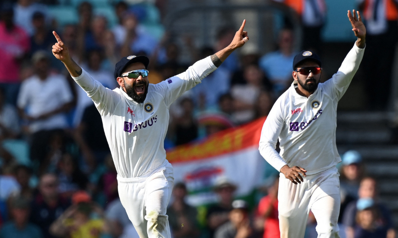 India's captain Virat Kohli (L) reacts after England's James Anderson lost his wicket during play on the fifth day of the fourth cricket Test match between England and India at the Oval cricket ground in London on Monday. — AFP