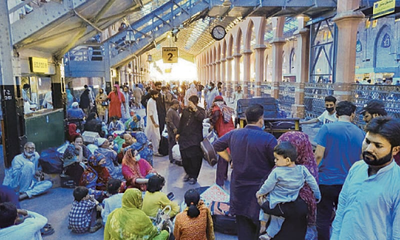 People throng the railway station following the closure of inter-city public transport in the wake of fresh Covid restrictions. — Dawn
