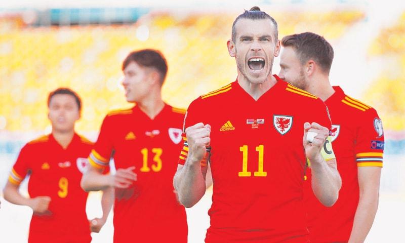 KAZAN: Wales' Gareth Bale celebrates after scoring during the World Cup qualifier against Belarus.—Reuters