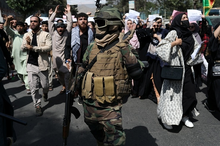 A Taliban soldier in combat gear stands amid the protesters during a protest in Kabul on Tuesday, Sep 7, 2021. — AP