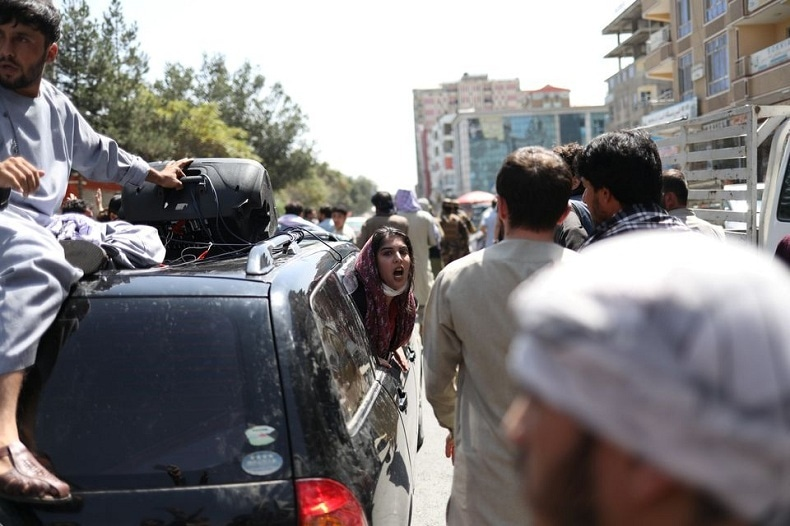 A woman chants from inside of a car during the protest in Kabul on Tuesday. — WANA via Reuters