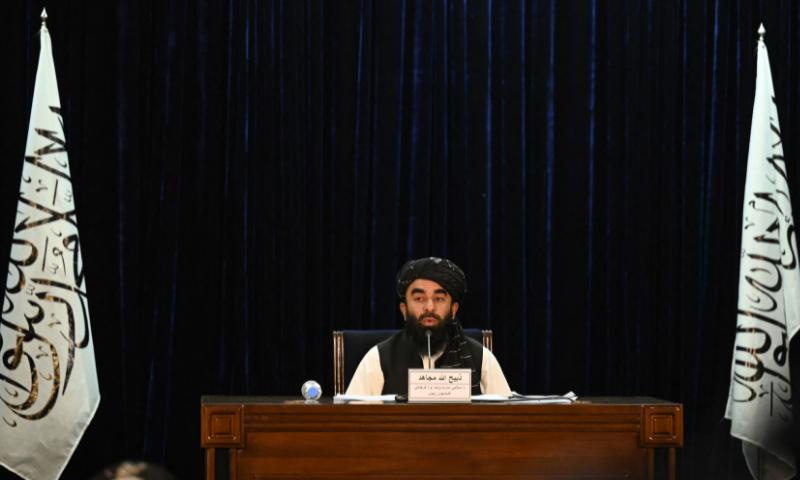 Taliban spokesman Zabihullah Mujahid addresses a press conference in Kabul on Tuesday. — AFP