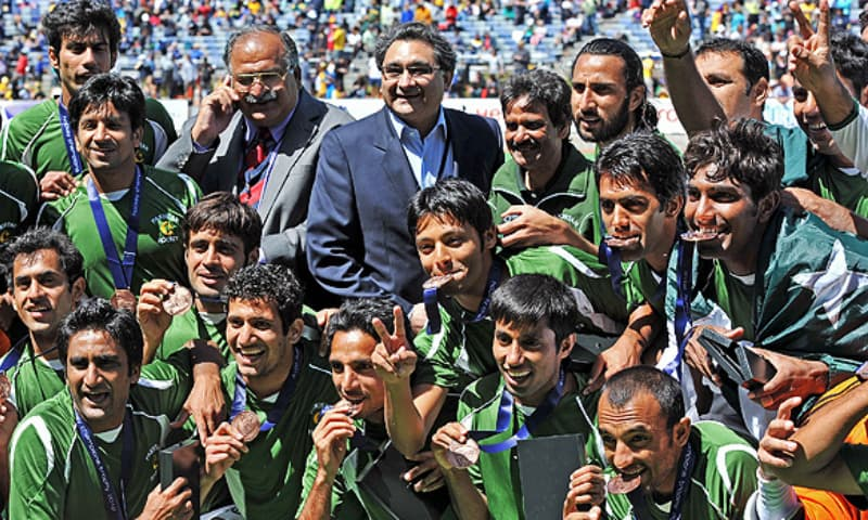 Pakistan hockey team celebrate with their bronze medals in the Champions Trophy. — AFP/File