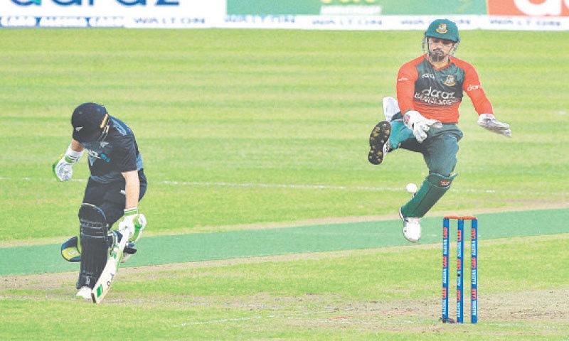 DHAKA: Bangladesh wicket-keeper Nurul Hasan tries to run out New Zealand captain Tom Latham during the fourth Twenty20 International at the Sher-e-Bangla National Cricket Stadium on Wednesday.—AFP
