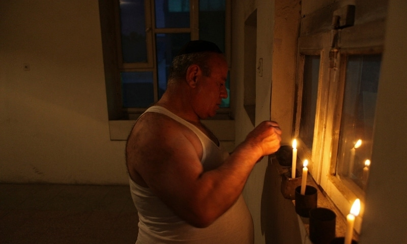 In this file photo, Zebulon Simentov, the last known Jew living in Afghanistan, lights the candles at the start of Shabbat in the synagogue he cares for in Kabul. — AP