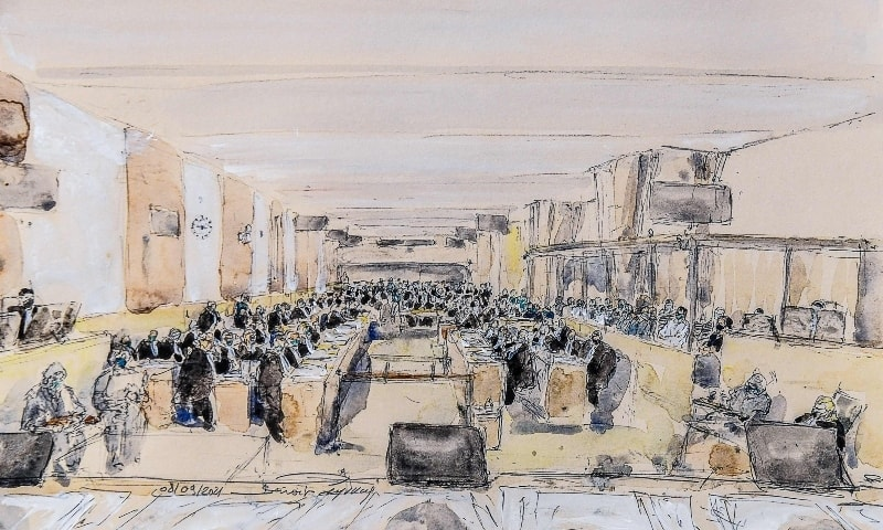 This court-sketch shows a general view during the first day of the trial of the November 2015 Paris and Saint-Denis attacks taking place in a temporary courtroom set up at the Paris' Palais de Justice historic courthouse on September 8. — AFP