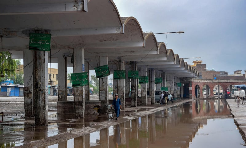 A boy walks at a closed bus station after the Khyber Pakhtunkhwa government imposed a ban on public transport as a preventive measure against the spread of the Covid-19 coronavirus in Peshawar. — AFP
