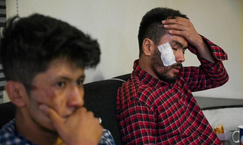 In this picture taken on September 8, Afghan newspaper Etilaatroz journalists Neamat Naqdi (R) and Taqi Daryabi sit in their office after being released from Taliban custody in Kabul. — AFP