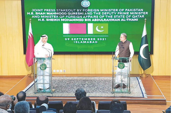 ISLAMABAD: Deputy Prime Minister and Minister of Foreign Affairs of Qatar Sheikh Mohammed bin Abdulrahman Al-Thani speaks next to Foreign Minister Shah Mahmood Qureshi during the press conference.—Reuters
