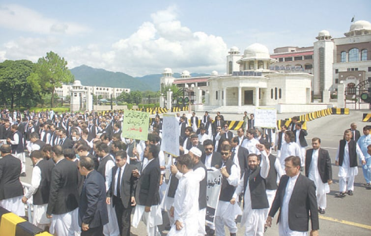 LAWYERS hold a protest outside the Prime Minister Secretariat in Islamabad on Thursday.—Online