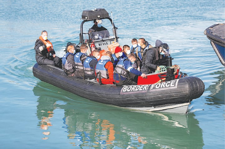 MIGRANTS rescued from the English Channel arrive at Britain's Dover harbour.—Reuters