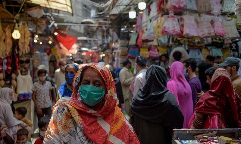 In this file photo, women shop at a market after the government eased the lockdown imposed as a preventive measure against the coronavirus in Rawalpindi. — AFP/File
