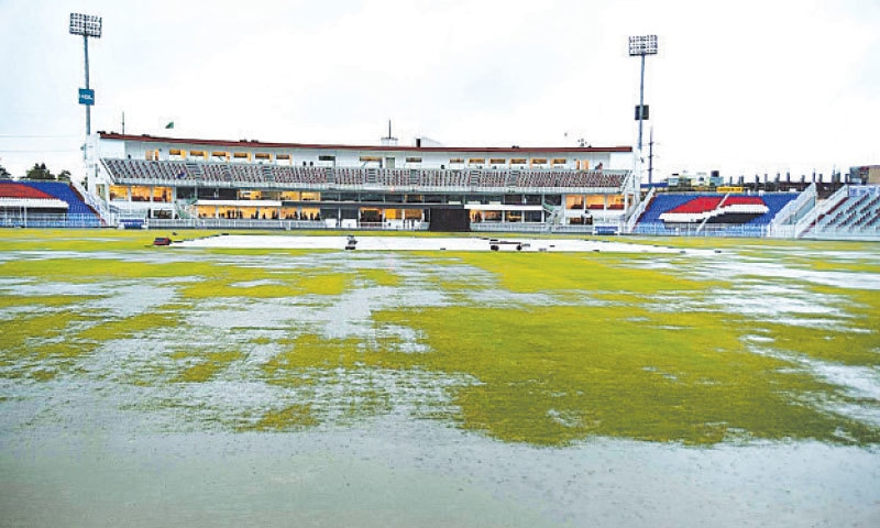 RAWALPINDI: A general view of the wet outfield of the Pindi Cricket Stadium after heavy rains on Friday. The downpour forced the cancellation of a training session of the Pakistan team, which is preparing for the upcoming ODI series against New Zealand.—APP