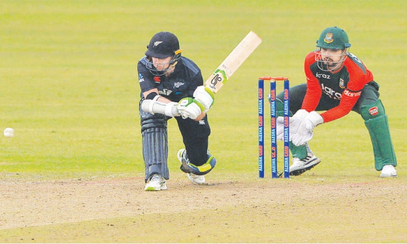 DHAKA: New Zealand captain Tom Latham prepares to sweep the ball as Bangladesh wicket-keeper Nurul Hasan looks during the fifth and final Twenty20 International at the Sher-e-Bangla National Cricket Stadium on Friday.—AFP