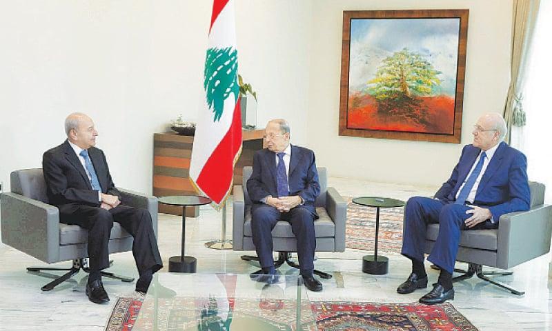BAABDA: Lebanon's President Michel Aoun (centre) meets prime minister-designate Najib Mikati (right) and Speaker of the Parliament Nabih Berri at the Presidential Palace on Friday.—Reuters